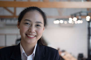 portrait of young businesswoman. asian woman smiling at camera at office