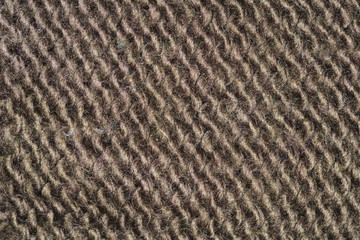 brown fabric texture, closeup on stitch