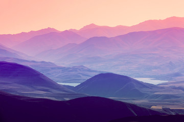 The layered silhouettes of mountains at sunset