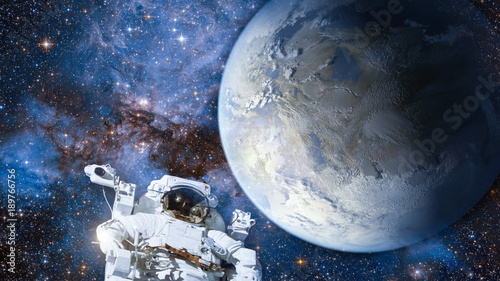 Wall mural Astronaut in outer space against colorful storm galaxy and earth. (Elements of this image furnished by NASA)