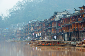 Fenghuang, China - January 10, 2015 : Boats on the Tuojiang River, Fenghuang ancient town, China