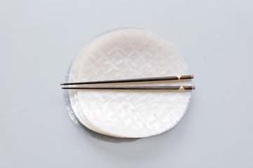 Chopsticks on dry rice wrappers