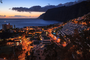 residential apartments in the background of Los Gigantes Cliffs, Tenerife, Spain