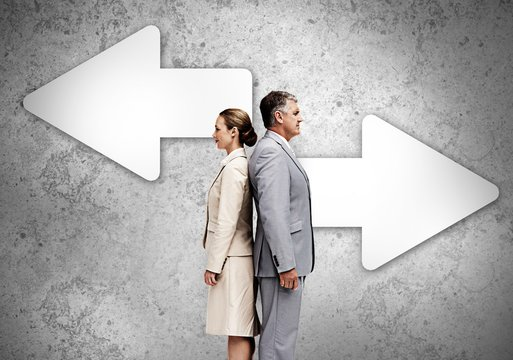 Business partners standing back-to-back on wall with arrows