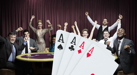 Attractive group cheering at the casino with digital hand of