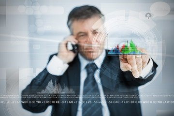 Businessman selecting graph from touchscreen