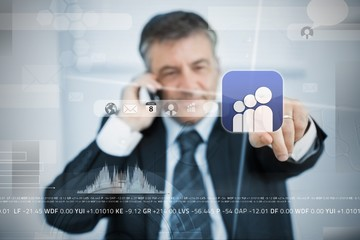 Businessman selecting social network application from