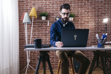 Man working on laptop in stylish office