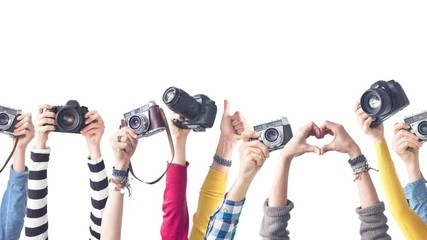 Wall Mural - Different colourful raised up arms holding camera