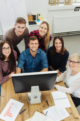 Motivated young business team at a desktop