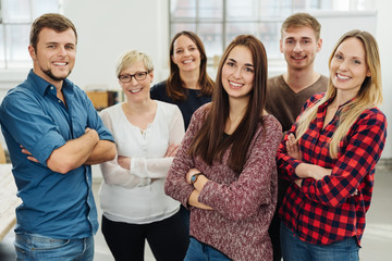 Group of smiling co-workers in office