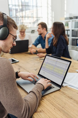Businessman working with headphones