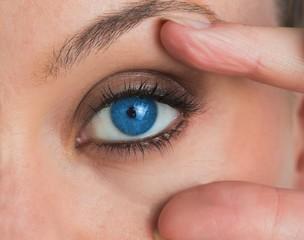 Woman stretching her eye