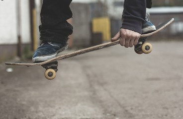 Skater grabbing his board mid air