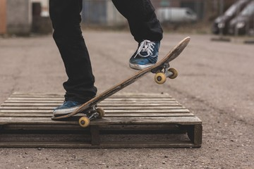 Skater doing manual trick on wooden crate