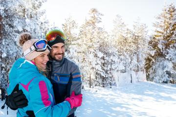 cheerful couple on winter holidays