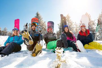 friends on mountain enjoying on winter day