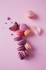 French macarons on pink background.