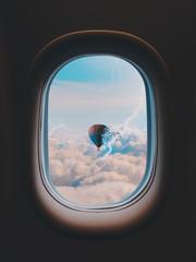 Hot air balloon through airplane window