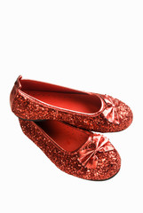 Pair of Red Glittered Shoes on a White Background