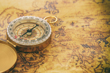 image of old compass over vintage map. selective focus.
