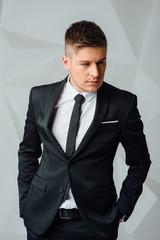 Portrait of handsome stylish man in elegant suit
