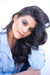 Beautiful woman's face with long dark hair