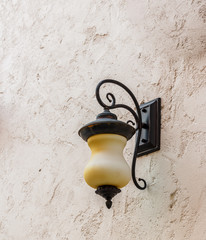 lamp light on the wall white cement. vintage style