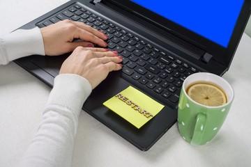 Blue screen of death, background laptop on the desktop and sticker restart