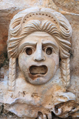 Decorative mask, stone carving, ancient