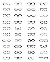 Silhouettes of different eyeglasses on a white background