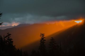 sunrise breaks through in one pillar of light