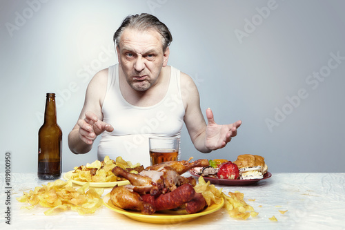 Aging Man In A Shirt Is Fan Of Unhealthy Lifestyle Stock Photo And Royalty Free Images On Fotolia