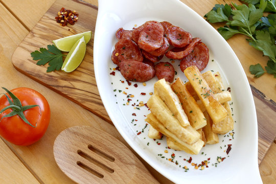 Sausage with fried yuca