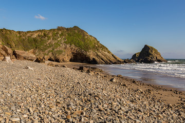 Pebble beach and cliffs at Monkstone Beach near Saundersfoot in Pembrokeshire, Wales, UK