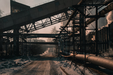 Beautiful types of winter-running thermal power plant with pipes and smoke and steam