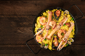 Spanish seafood paella in paellera with copyspace
