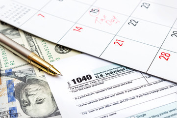 Tax concept. Tax form with pen, calendar and money.