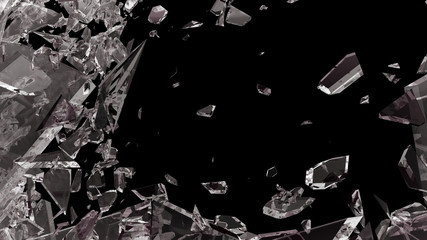Pieces of shattered glass isolated on black