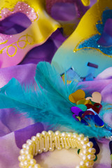 Carnival party background with confetti, masks and accessories