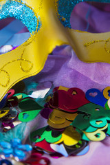 Carnival party background with confetti, serpentine and masks