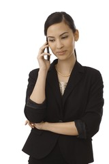 Young businesswoman talking on mobilephone