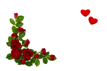 Red roses and hearts on a white background with space for text. Top view, flat lay. Valentine decoration.