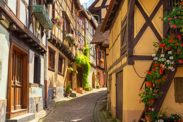 romantic alley in medieval town in Eguisheim, Alsace, France