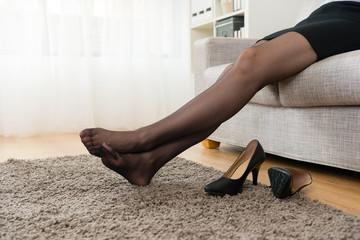 beautiful business woman take off high heel shoes