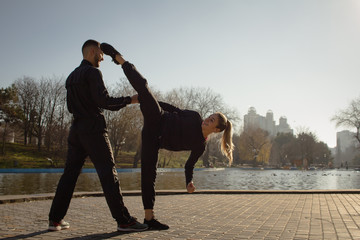 young couple training self defense fight exercises, karate male and female practicing