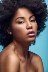 Young african woman isolated on blue wall studio fashion photoshoot sensuality