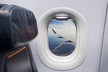 airplane seat and window inside an sea