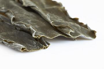Dried kombu seaweed (Laminariaceae longissima) isolated on white background