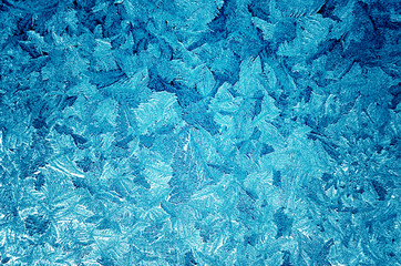 Icy frosty pattern on a window.Abstract background.
